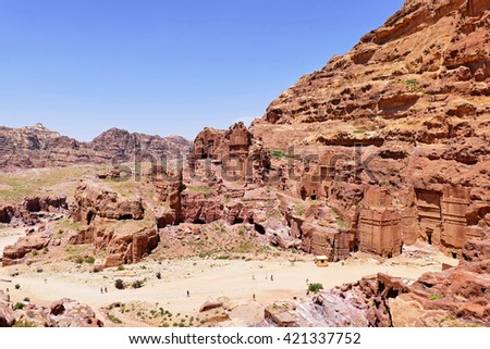 Scenic View Ancient Nabataean Rock-Cut Royal Tombs Complex Ruins on Rose Red Color Rocky Mountain in The Lost City of Petra, Jordan - stock photo