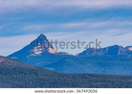 scenic view Mount Thielsen, or Big Cowhorn, is an extinct shield volcano in the Oregon High Cascades,view from crater lake,Oregon,usa. - stock photo