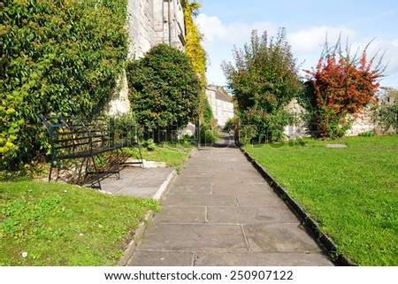Scenic View of a Pathway through a Beautiful Park Garden - stock photo
