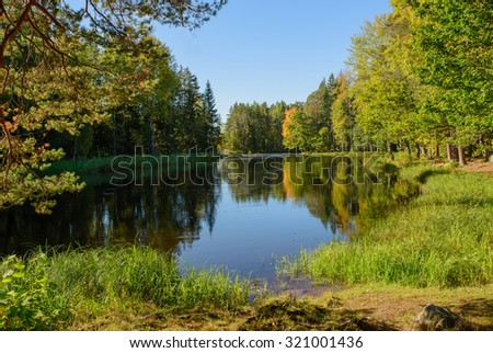 Scenic view of a river in autumn - stock photo