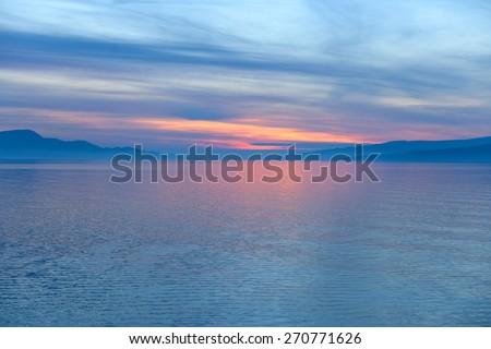 Scenic view of a small island in the sea - stock photo