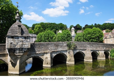 Scenic View of an Old Stone Bridge over a River in a Picturesque Town - Namely the Landmark Packhorse Bridge Spanning the River Avon in the Town of Bradford on Avon in Wiltshire England