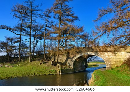 Scenic view of arched stone bridge over Lancaster Canal, Farleton, Cumbria, England.