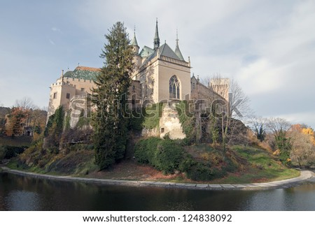 Scenic view of autumn Bojnice castle with moat in foreground, Slovakia - stock photo