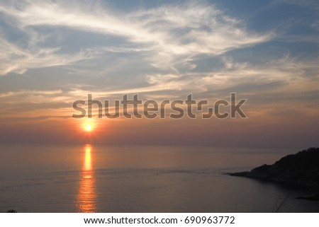 Scenic view of beautiful sunset with clouds over the sea.