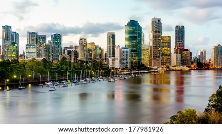 Scenic view of Brisbane River and Cityscape from Kangaroo Point Cliffs late afternoon. HDR image. - stock photo