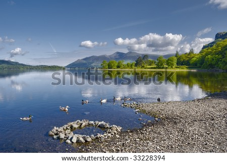 Scenic view of Derwent Water lake with Skiddaw mountain in background, Lake District National Park, Cumbria, England. - stock photo