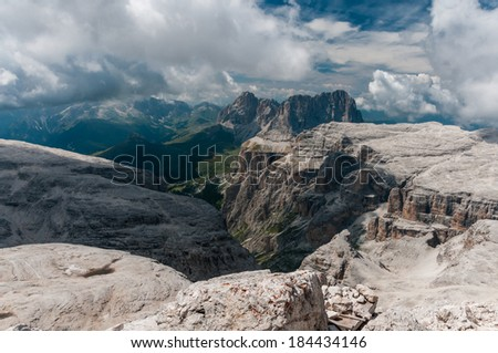 Scenic view of Dolomites mountains with dramatic clouds. Italy, Europe. - stock photo