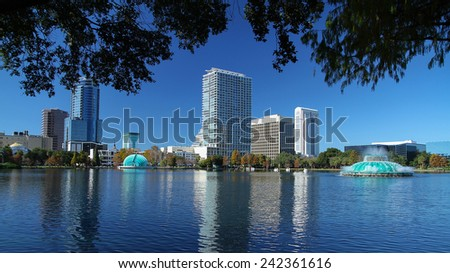 Scenic view of downtown Orlando's skyline as seen from Lake Eola Park - stock photo