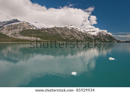 Scenic view of Glacier Bay National Park with reflection in sea and floating icebergs. - stock photo