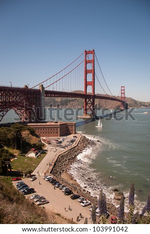 Scenic view of Golden Gate Bridge and historic Fort Point on a sunny day seen from San Francisco. / Golden Gate Bridge San Francisco California - stock photo