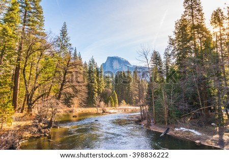scenic view of half dome with reflection on the water in the morning,Yosemite National park,California,usa.  - stock photo