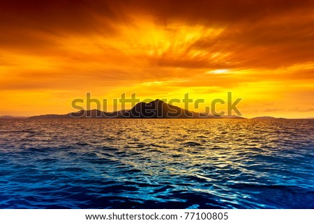 Scenic view of island during sunset - stock photo