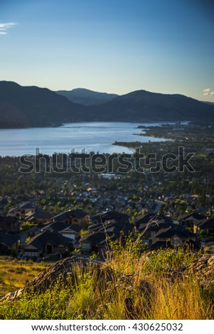 Scenic View of Kelowna and Okanagan Valley Landscape at Sunset - stock photo