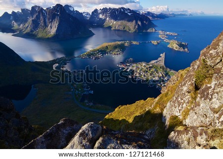 Scenic view of Lofoten islands from top of mountain Reinebringen with picturesque town of Reine and surrounding fjords