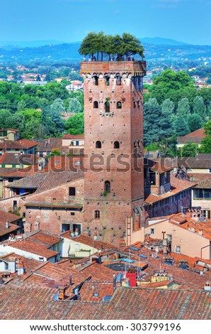 Scenic view of Lucca and Guinigi tower from Torre delle Ore, Lucca, Italy  (hdr image) - stock photo