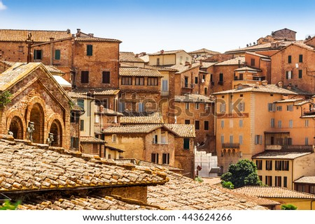 Scenic view of many old houses in historical town of Siena, Tuscany, Italy. - stock photo