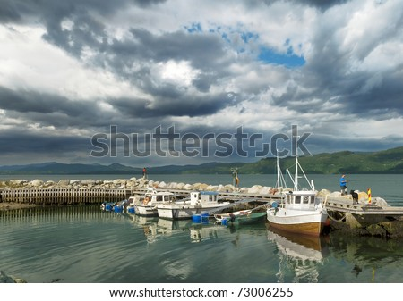 Scenic view of moored boats at fjord - stock photo