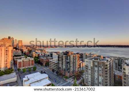 Scenic view of mountain Rainer during sunset. Downtown and port of Seattle, WA state - stock photo