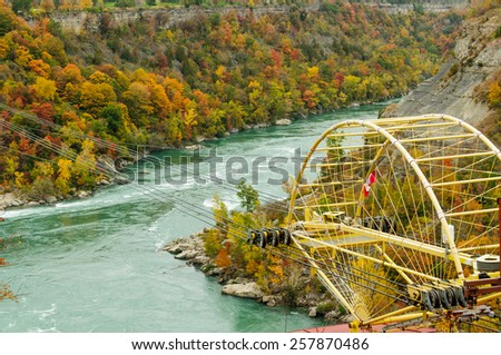 scenic view of Niagara river with aero car crossing the Whirlpool in autumn, Ontario Canada - stock photo