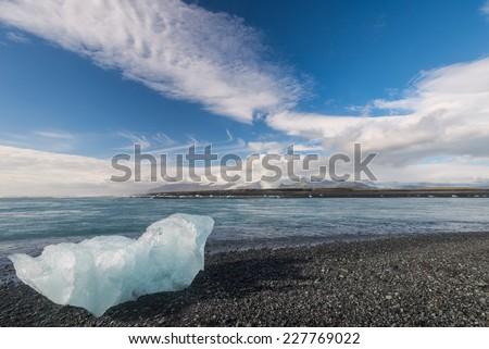 Scenic view of ocean shore with iceberg near Jokulsarlon lagoon, Iceland. - stock photo