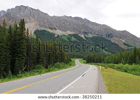 Scenic view of rocky mountains and highway 40 while traveling in kananaskis country, alberta, canada