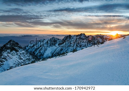 Scenic view of snowy winter mountains with colorful sunset, Rysy - High Tatras, Slovakia