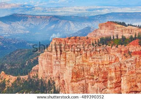 Scenic view of stunning red, orange, pink and yellow sandstone hoodoos in Bryce Canyon National Park in Utah, USA