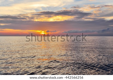 Scenic view of sunrise with colorful dramatic sky cloud above the sea in Khanh Hoa province. Early morning seascape, sunrise on the beach at the central coast of Vietnam. Nature background. - stock photo
