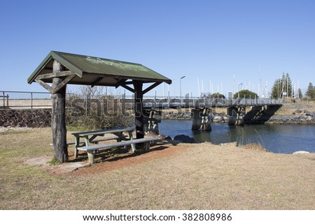 Scenic view of the  concrete  traffic bridge over the  the Leschenault Estuary  in Bunbury, Western Australia on a sunny afternoon in late spring.