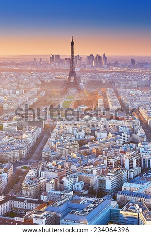 Scenic view of the Eiffel tower at sunset - stock photo