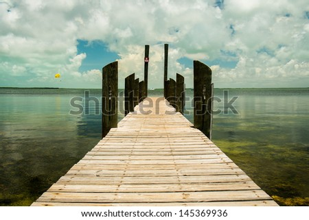 Scenic view of the Florida Keys with a dock along the bay. - stock photo