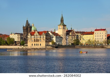 Scenic view of the Old Town ancient architecture and Vltava river pier in Prague, Czech Republic