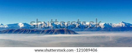 Scenic view of the winter mountains with snow - stock photo