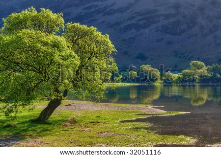 Scenic view of trees on shore of Lake Ullswater. Lake District National Park, Cumbria, England - stock photo