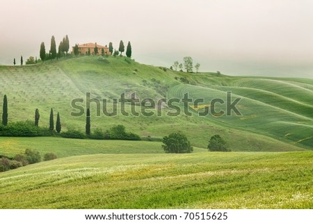 Scenic view of typical Tuscany mist landscape - stock photo