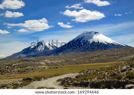 Scenic view of volcanic group. Payachata volcanic group at Lauca National Park, Chile  Lauca National Park is located in Chile's far north, in the Andean range.   - stock photo