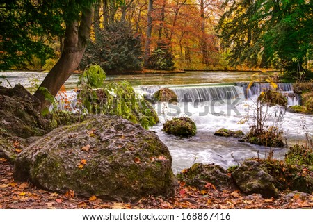 Scenic view of waterfall on Isar river in English Garden Park, Munich, Germany. - stock photo