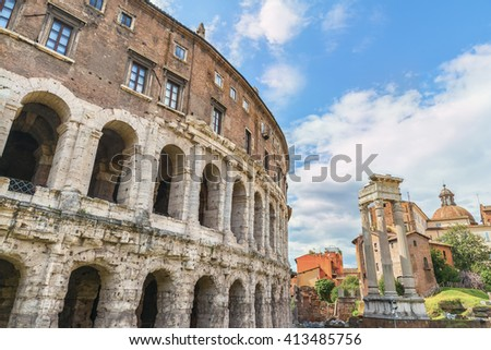 Scenic view on the ancient Theatre of Marcellus( Teatro di Marcello ) and ruin of old building( antique columns and detail of the cornice ) next to it on the background of clouds.Rome.Italy.Europe. - stock photo