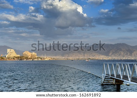 Scenic view on the Red Sea from the central beach of Eilat - famous resort and recreation city in Israel - stock photo