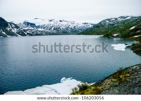 Scenic view over a mountain lake. - stock photo