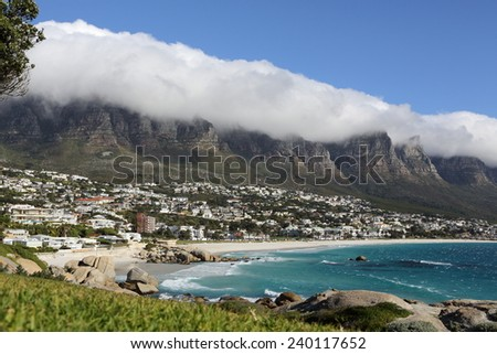 Scenic view over Camps Bay and the Twelve Apostles mountains in Cape Town - South Africa. - stock photo