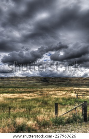 Scenic views of rural Montana farm country under stormy skies - stock photo