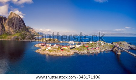 Scenic village Hamnoya with traditional red rorbu cabins on Lofoten islands in Norway - stock photo