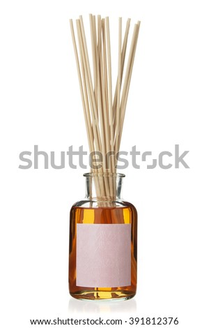 Scent diffuser with wooden sticks over white background - stock photo