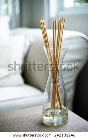 Scent sticks aromatic in jar on table - stock photo