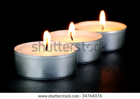 Scented candals isolated against a black background - stock photo