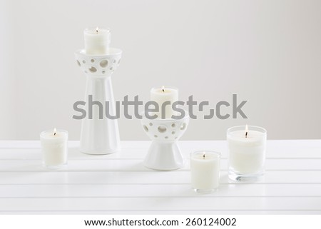 scented candles on white background - stock photo