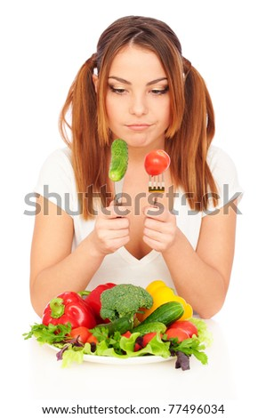 sceptical woman looking on fresh vegetables. isolated on white background - stock photo