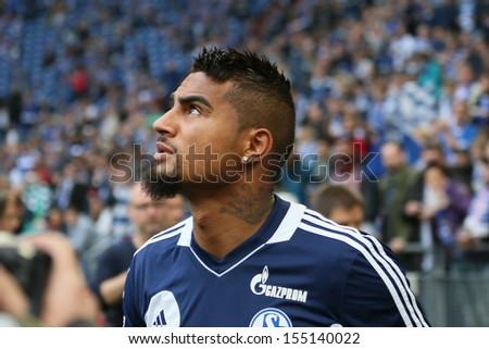 SCHALKE, GERMANY - SEP 21: Kevin-Prince Boateng (Schalke 04) during a Bundesliga match between FC Schalke 04 & FC Bayern Munich, final score 0-4, on September 21, 2013, in Schalke, Germany. - stock photo